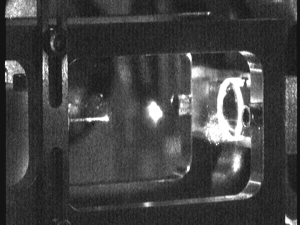 Rubidium 3D MOT (center) in front of the hollow core fiber (left) inside the vacuum chamber.